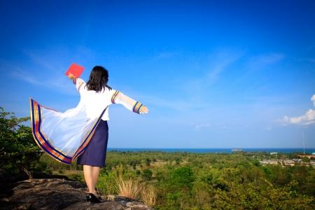 Back of Thai graduates with blue sky photo
