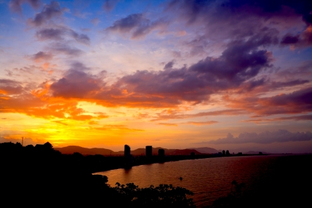 Silhouette of HuaHin city on sunset, Thailand photo