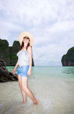 Beautiful asian woman standing on the beach photo
