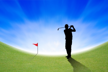 Silhouette of Golfer on green and blue sky photo