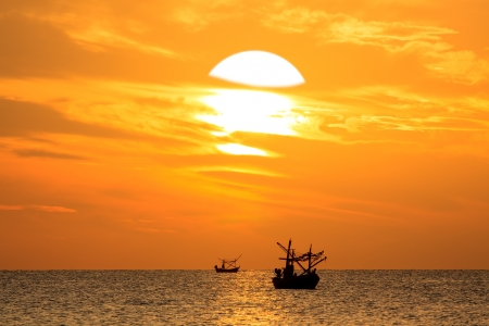 Silhouette of Thai Fishing Boat on sunset, HuaHin Thailand photo
