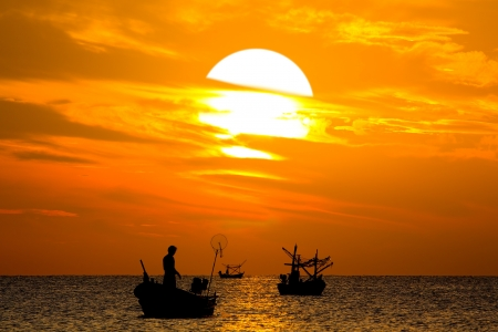 Silhouette of Thai Fishing Boat on sunset, HuaHin Thailand Stock Photo