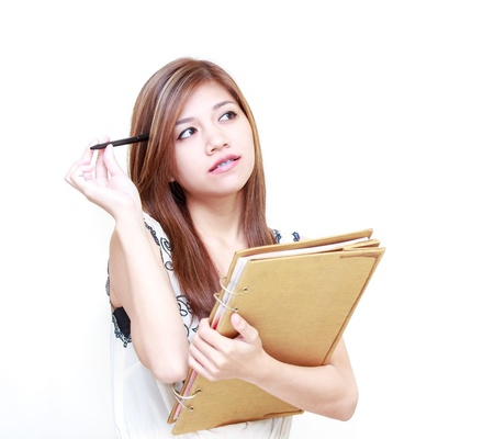 Young Asian Woman writing diary or thinking on white background Stock Photo