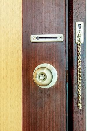 Door knob on wood door background photo