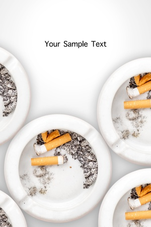 Smoked cigarettes in white ashtray on wood table Stock Photo - 15373732