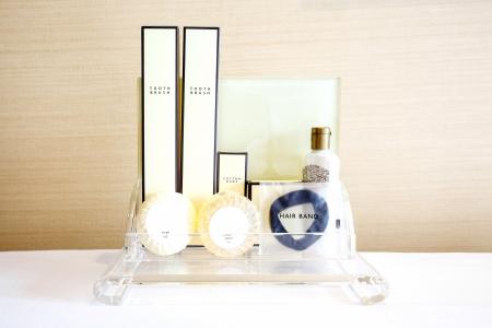 Amenities kit on shelf in bathroom