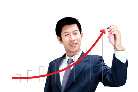 Asian business man drawing a graph of his business growth photo