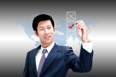 Asian business man choose check mark on box photo