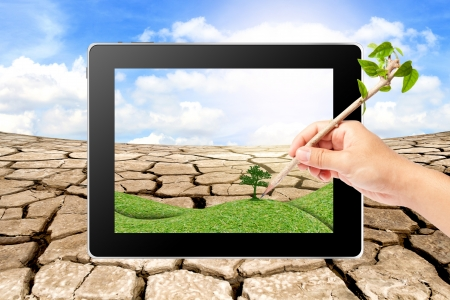 Hand writing Think Green Ecology on tablet Stock Photo - 16404388