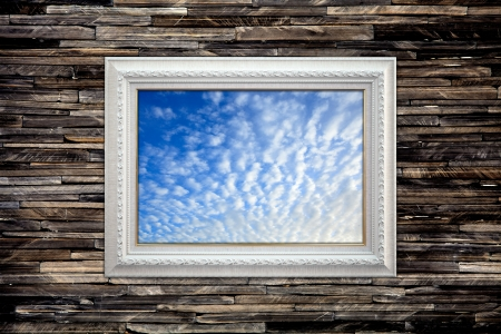 Blue sky picture frame on the granite wall, vintage background photo