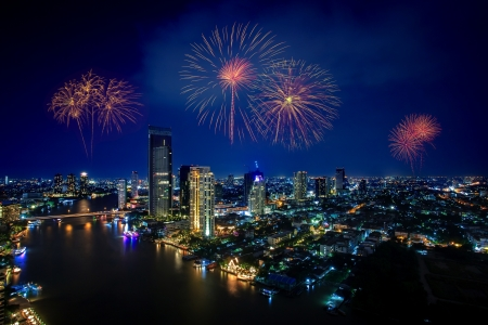 Firework of Cityscape at Night in Bangkok, Thailand Stock Photo