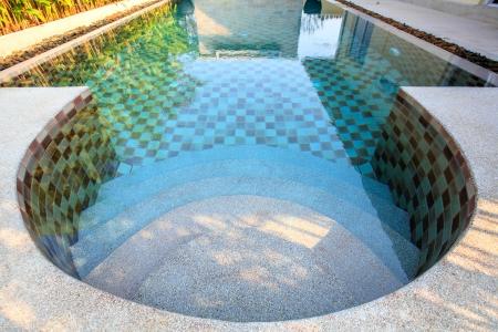 Small swimming pool in a yard photo