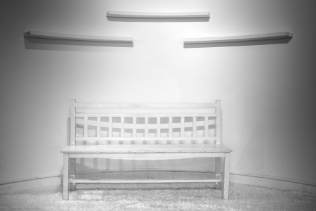 Empty chair with white wall photo