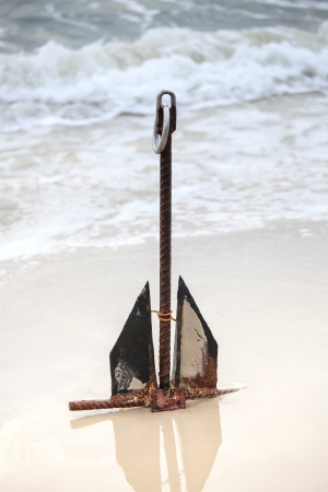 submerging: Anchor on the beach  Stock Photo