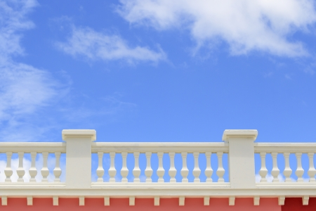 parapet wall: Close-up of vintage balcony with blue sky