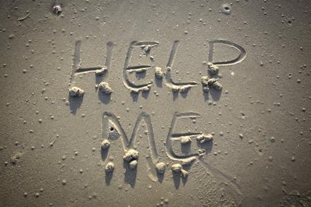 Help me - Inscription on the sand of tropical beach
