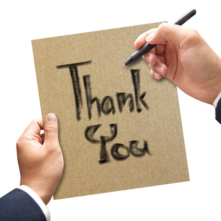 Man hand writing Thank you on the paper photo