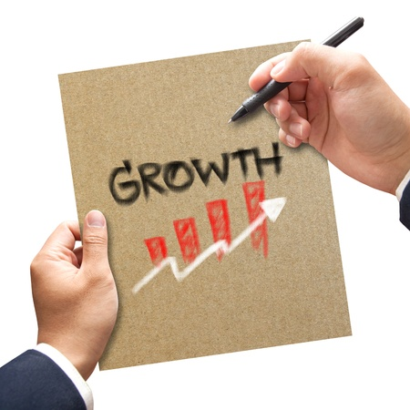 Business hand with pen writing growth on paper concept photo