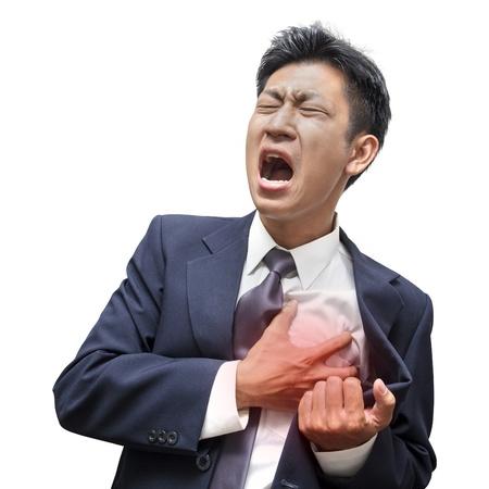 dolor de pecho: Empresario ataque al corazón en aislado Foto de archivo