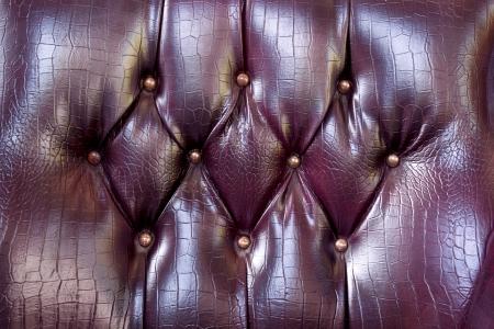 burgundy upholstery leather pattern background photo
