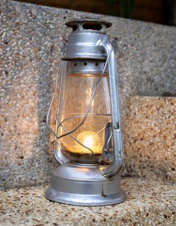 scintillating: Background burning vintage lamp, concept lighting Stock Photo