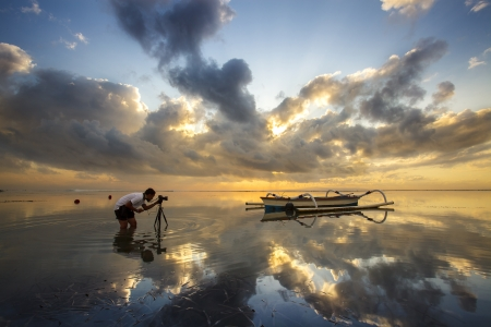 The Photographer takes a good shot on the sea, Indonesia photo