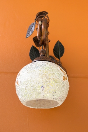 Classic lamp on the orange wall Stock Photo - 24912784