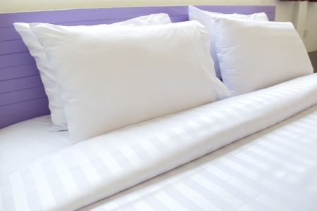 White pillows on a bed Comfortable soft pillows on the bed Stock Photo