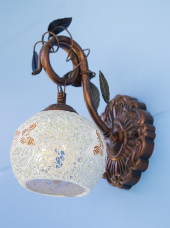 wall sconce: Classic lamp on the blue wall Stock Photo