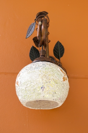 Classic lamp on the orange wall Stock Photo - 24969723