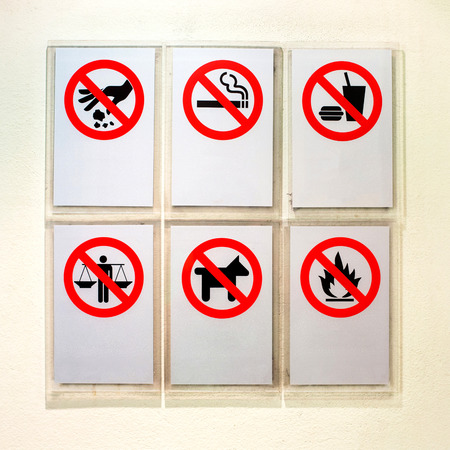 Prohibitory information signs on sky train - Thailand photo