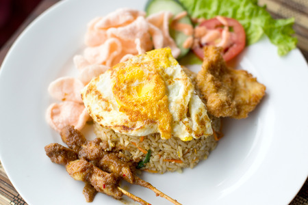 goreng: Nasi Goreng with prawn crackers and chicken satay - Indonesian dish