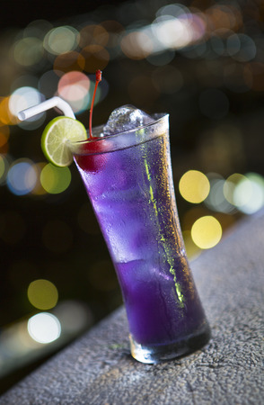 Purple cocktail in a glasses at night life photo