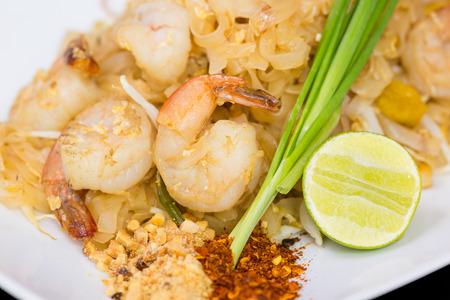 Thai style noodles on white plate photo