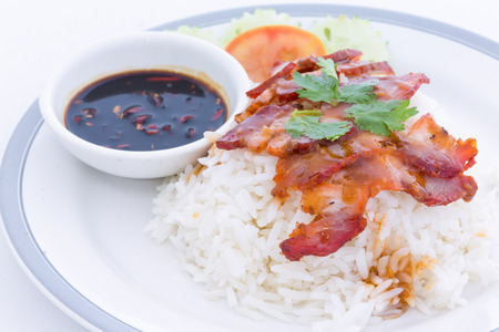 dinning table: serving of rice with roasted pork on top