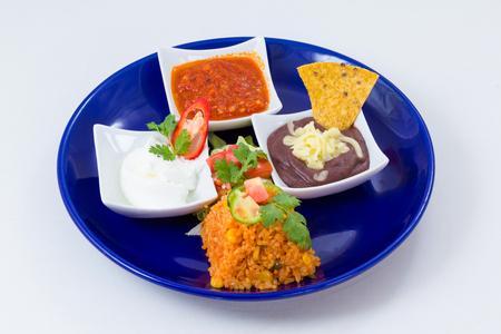 základní: Mexické dipsy a přílohy - Salsa, Guacamole, Sour Cream & Refried Beans Reklamní fotografie
