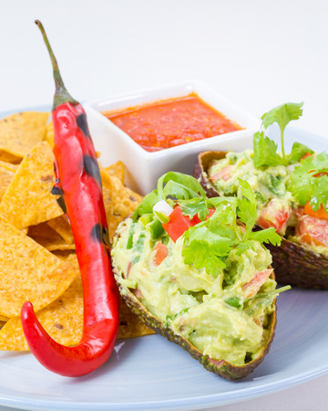 nacho chip: Homemade Fresh Guacamole with Chips on white plate