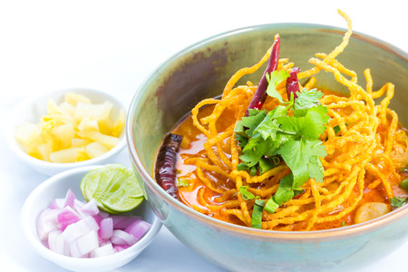 soi: Curried Noodle Soup (Khao soi) with coconut milk, Northern Thai cuisine. Stock Photo
