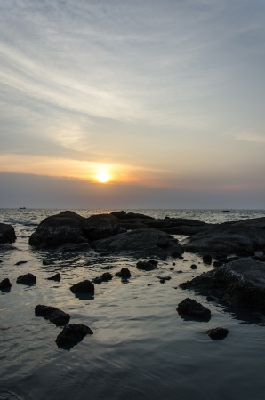 Scenic view of sunset above the sea photo