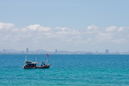 Fisher man boat on the sea in PATTAYA Stock Photo