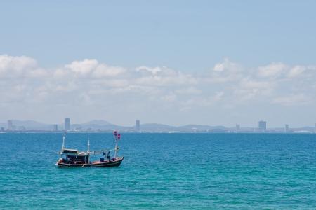 fisherman boat: Fisher man boat on the sea in PATTAYA Stock Photo