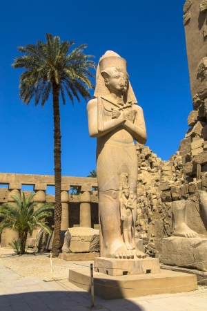Ramses II enormous stone statue in peristyle courtyard in the Temple of Amun-Ra at Karnak  Antique Thebes  Luxor, Egypt