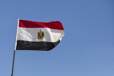 edel: Flag of Egypt against blue sky