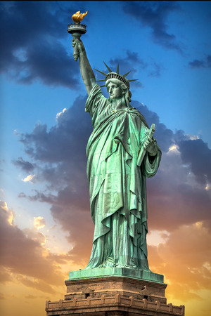 Liberty Statue in Manhattan New York at sunset USA