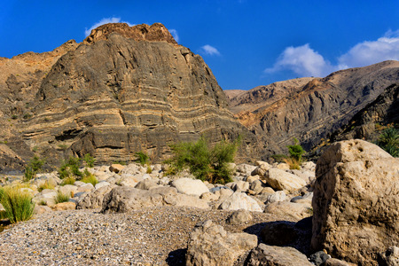 bani: Colorful rocks in Wadi Bani Khalid near Muscat, Oman Stock Photo