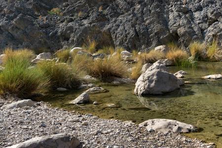 Colorful rocks in Wadi Bani Khalid near Muscat, Oman Stock Photo