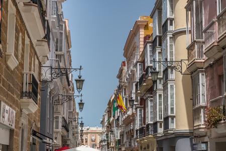 view of a narrow street in spanish city cadiz