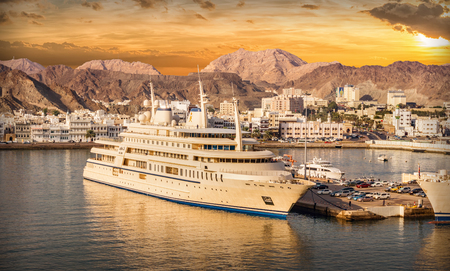 muttrah: Muscat, Oman - December 22, 2015: Port of Muscat in Oman with ships at sunset