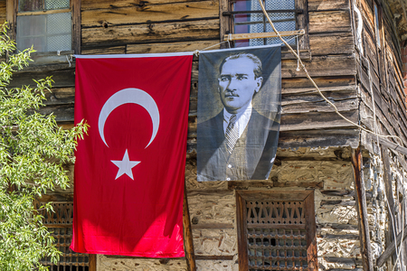 Turkish flag with picture of Atatuerk