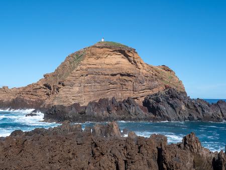 Mole islet in Porto Moniz in Madeira, Portugal Standard-Bild - 121899094
